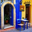 Traditional greek streets with small tavernas — Stock Photo #12798549