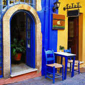 Traditional greek streets with small tavernas — Stock Photo