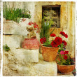 Pictorial details of Greece - old door with flowers - retro styled picture - Foto de Stock