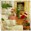 Stock Photo: Pictorial details of Greece - old door with flowers - retro styled picture