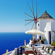 图库照片: Santorini - view with restaurant and windmill