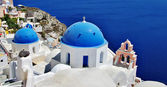 Santorini with traditional white-blue domes — Stock Photo