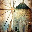 Old windmill on Santorini - picture in retro style - Stock Photo