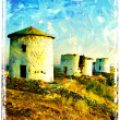 Ancient windmills on sunset - picture in vintage painting style — Stock Photo