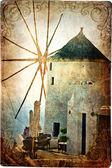 Old windmill on Santorini - picture in retro style — Stock Photo