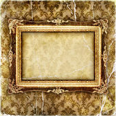 Vintage tattered wallpaper with picture frame — Stock Photo