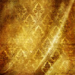 Foto Stock: Golden folded background with classic patterns
