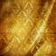Golden folded background with classic patterns - Foto Stock