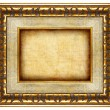 Antique carved frame with blank canvas — Stock Photo