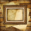 Vintage background from old papers and blank antique frame — Stock Photo #12820726