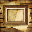 Vintage background from old papers and blank antique frame — Stock Photo