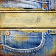 Old jeans background with place for text — ストック写真