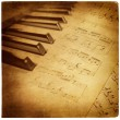 Vintage musical background with piano keys — Stock Photo #12821106