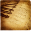 Stock Photo: Vintage musical background with piano keys