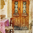 Stock Photo: Pictorial old greek streets with tavernas - retro styled picture