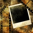 Grunge background with film strips and instant frame — Stock Photo