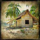 Hut on the tropical beach - retro styled picture — Stock Photo