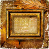 Autumn composition with wooden frame and leaves — Stock Photo