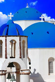 Blue churches domes - symbol of unique Santorini — Stock Photo