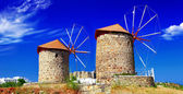 Greek landscapes. windmills on Patmos island — Stock Photo