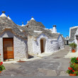 Stock Photo: Unique Trulli houses with conical roofs in Alberobello, Italy