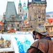 Prague, painter drawing Charles bridge — Stockfoto #38872853