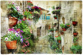 Charming floral streets in Spello, Umbria Italy, artistic pictur — Stock Photo