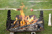Sausage on fire — Stock Photo