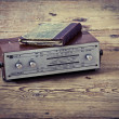 Foto Stock: Old book on old radio