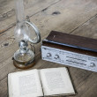 Stock Photo: Kerosene lamp and radio and book