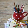 Vintage crayons in the red cup — Stok fotoğraf