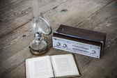 Kerosene lamp and radio and book — Stock Photo