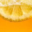 Lemon in the beer bubbles — Stock Photo