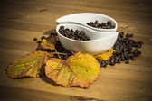 Cups with coffee beans on a wooden table — Stock Photo