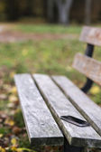 Lost phone on the bench — Stock Photo