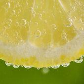 Lemon in the bubbles — Stock Photo