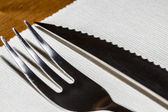Steak cuttlery - fork and knife on the table — Stock Photo