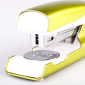 Light green stapler isolated on white — Stockfoto