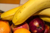 Yellow bananas, apples and oranges a still-life — Stock Photo