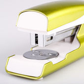 Light green stapler isolated on white — Stock Photo