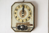 Retro wall clock on old background — Stock Photo
