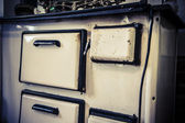 Old white metal oven — Stock Photo