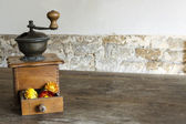 Vintage wooden coffee mill grinder with yellow flowers in open drawer — Stock Photo