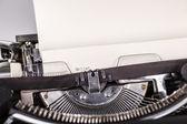 Paper in typewriter — Stock Photo