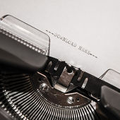 Old typewriter with text download here — Stok fotoğraf