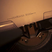 Old typewriter with text download here — Stock Photo