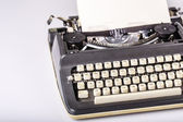 Paper in typewriter — Stockfoto