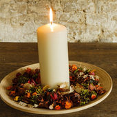 Candle on the wooden plate  — Stock Photo
