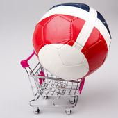 Shopping cart with soccer ball on white background — Stock Photo