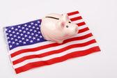 Pig money box and USA flag — Stock Photo